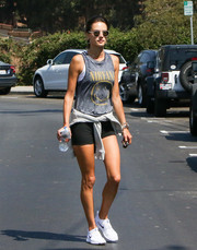 Alessandra Ambrosio teamed her top with a pair of black bike shorts.