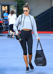 Alessandra Ambrosio headed out in LA looking relaxed in a cropped gray hoodie.