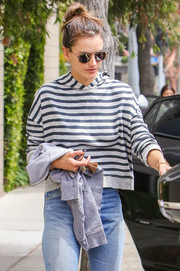 Alessandra Ambrosio put on a pair of round tortoiseshell shades by Krewe for a day out in LA.