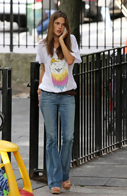 Alessandra went casual in this eagle tee and bootleg jeans.