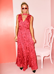 Paris Hilton looked ultra feminine in a printed maxi dress by Alice + Olivia during the brand's presentation.