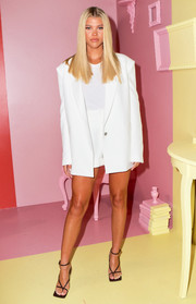 Sofia Richie styled her look with a pair of strappy black heels.