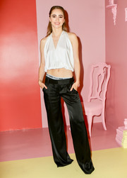 Suki Waterhouse sealed off her look with black satin trousers, also by Alice + Olivia.