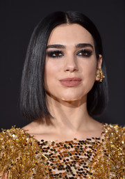Dua Lipa went heavy on the eyeshadow for a smoldering beauty look.