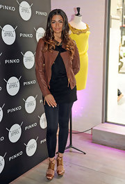 Camila Alves struck a pose in metallic bronze Stella McCartney Fish-scale platform sandals.