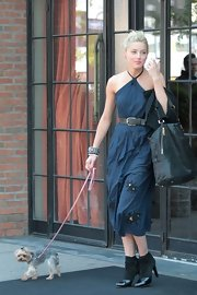 Amber Heard wore a pair of black suede and patent leather heeled ankle boots while out walking her adorable dog.