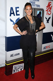 Adrienne looked chic and stylish in an all black ensemble complete with a thigh high pair of black leather boots. Adrienne is a great friend of the Kardashian sisters and it's obvious that she shares their sense of style.