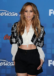 JLo dons a cropped plaid jacket with shorts to show off her fierce abs at the American Idol finalist party.