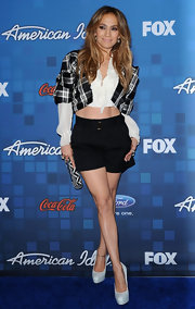 Jennifer Lopez added flair to her look with a black and white striped Iris calf hair clutch.