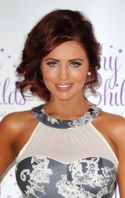 Amy Childs swept her vibrant curls up into a messy 'do for the launch of her new clothing line.