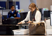 Amy Adams passed through security at LAX carrying a Louis Vuitton monogrammed tote.