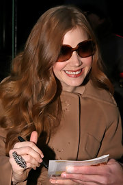 An always adorable Amy Adams donned square shaped tortoiseshell sunglasses.