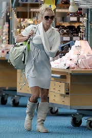 Pamela Anderson showed off her casual style while hitting the airport in sheepskin boots.
