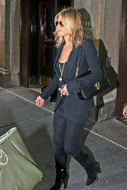 Jennifer Aniston was out and about in NYC in an all black ensemble. She accessorized her look with a gold leather shoulder bag with gold hardware.