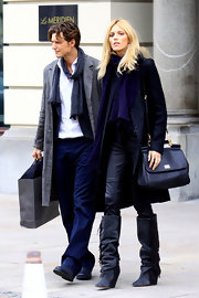 Anja Rubik caught a flight out of Poland carrying a smart black leather shoulder bag.