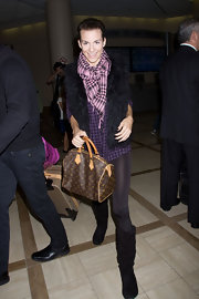 Rachel Mccord completed her cozy travel get-up with a patterned scarf.