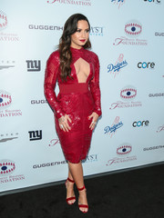 Demi Lovato complemented her dress with red velvet sandals by Gianvito Rossi.