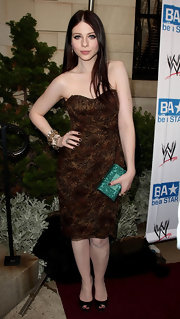 Michelle Trachtenberg carried a dazzling emerald green crystal inlaid clutch to the Anti-Bullying Alliance launch.