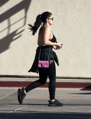Ariel Winter punctuated her black outfit with a bejeweled pink bag by Gucci for a day out in LA.