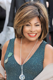 Tina Turner's neat bouffant kept her hair looked glamorous and big, but still sleek and well-managed.