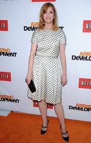 Judy Greer chose a stylish white frock with black polka dots for her fun and flirty red carpet look at the premiere of 'Arrested Development.'