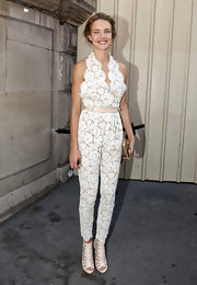 Natalia Vodianova opted for a fashion forward look at the Stella McCartney show. The statuesque beauty donned a white lace jumpsuit paired with fierce strappy sandals.
