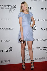 Jaime completed her little blue dress with metallic silver accessories including a hard case box clutch.