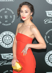 Cara Santana was bold with her colors at the Art of Elysium Heaven Gala, pairing a faceted yellow Atelier Swarovski clutch with a red-orange gown!