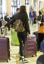 Kendall traveled in style with her handy designer backpack.