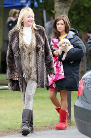 Ashley wore a bright red pair of high top sheepskin boots. The actress stayed warm and cozy while on set.