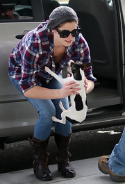 Ashley Greene plays with her pup in a flannel shirt and leather lace-up boots.