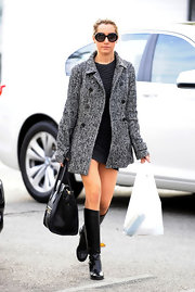 Ashley Tisdale may have forgotten her pants, but she did attempt to keep warm with a chic black-and-white tweed coat while running errands.