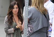 Ashley paired her printed cardigan with an arm full of beaded bracelets.