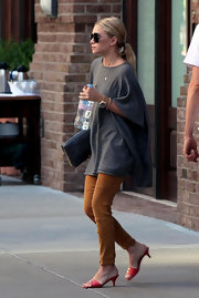 Ashley Olsen left her NYC apartment with a pair of pink heeled Chanel slide sandals on her feet.