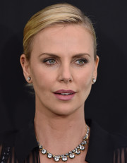 Charlize Theron kept it classic with a pair of diamond studs by Fred Leighton.