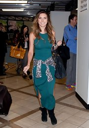 Audrina Patridge traveling in style in a  maxi dress paired with a leopard cardigan.