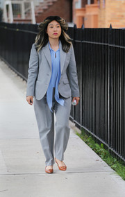 Awkwafina filmed 'Nora from Queens' looking business-chic in a gray pantsuit.