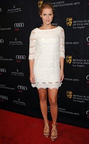 Claire Holt looked sweet and feminine on the red carpet when she sported this white lace frock.