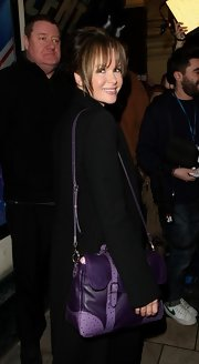 Amanda Holden carried a rich-looking purple leather tote as she left the Palladium after 'Britain's Got Talent' auditions.