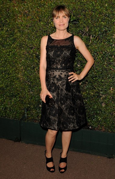 Radha Mitchell contrasted her delicate dress with a pair of chunky black sandals.