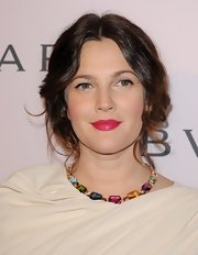 Drew Barrymore added some pop to her peachy skin with bright pink lips!
