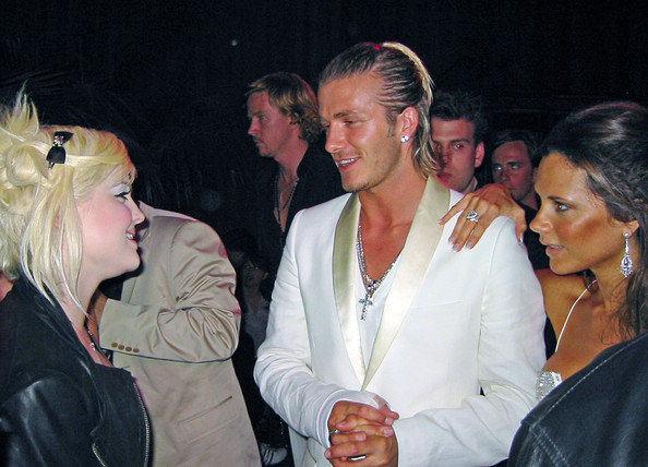 David Beckham takes a gamble with this half up half down hairstyle.  Bold, but not beautiful.
