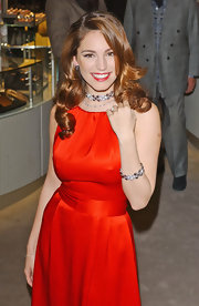 Kelly Brook styled her radiant locks in glamorous curls at an event.