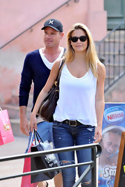BarRefaeli tucked her white tank into jeans for her casual look in Saint Tropez.