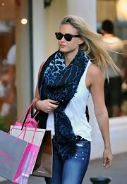 Bar tossed on a blue leopard print scarf while out shopping in Saint Tropez.
