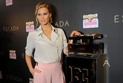 Bar Refaeli paired her high-waisted slacks with an egg shell nude zip-up blouse for Escada's fragrance launch.