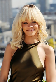 Rihanna wore her hair in long blond waves with lash-grazing bangs while attending a photocall for 'Battleship.'