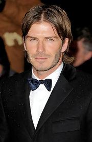 David Beckham added a little color to his black suit with a satin navy bowtie.