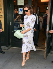 Victoria Beckham styled her look with a chic mint-green leather tote.