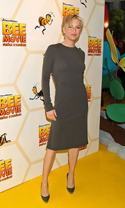 Renee Zellweger matched her gray long-sleeved dress with matching platform pumps.